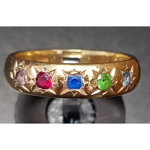 67 - MULTI GEM SET GYPSY STYLE RING with flush set aquamarine, peridot, sapphire, ruby and pink topaz, on...