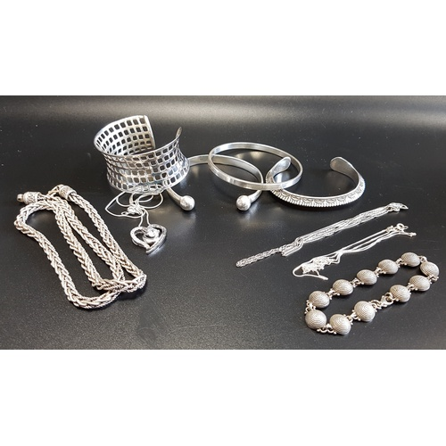 2 - SELECTION OF SILVER JEWELLERY comprising four bangles including one pierced mesh style example; a he...