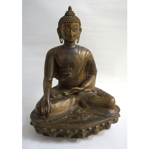 202 - 19TH CENTURY BRONZE BUDDHA SHAKYAMUNI seated with legs crossed with one hand across his lap with the...