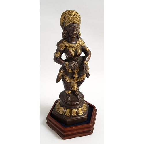 197 - INDIAN GILT BRONZE DEITY of Gowrie, possibly from Kerala in Southern India, on a hexagonal hardwood ...