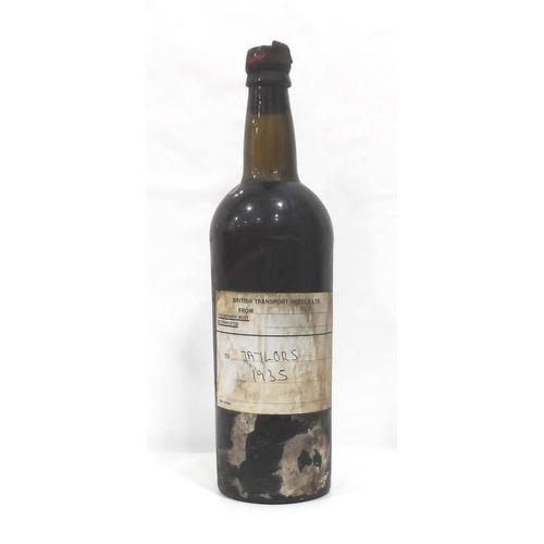 21 - TAYLOR'S 1935 VINTAGE PORT A bottle of Taylor's 1935 Vintage Port.  The original labels are missing ...