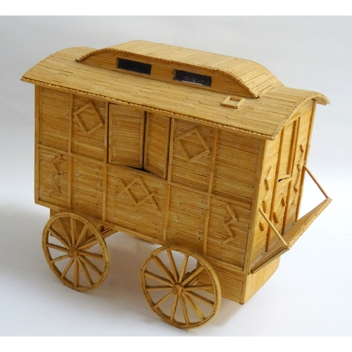 214 - MATCHSTICK MODEL OF A HORSE DRAWN TRAVELLER'S CARAVAN with movable window shutters and door, a set o...