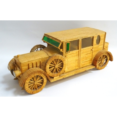 215 - MATCHBOX MODEL OF A SEDAN MOTOR CAR with perspex windows and two spare tyres, 36cm long...