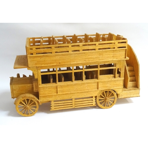 216 - MATCHSTICK MODEL OF AN OPEN TOP BUS FROM THE 1900s 41.5cm long...