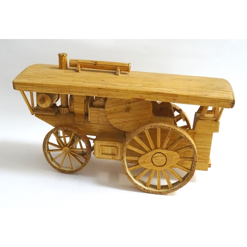 217 - MATCHSTICK MODEL OF A TRACTION ENGINE with a canopy roof, 33cm long...