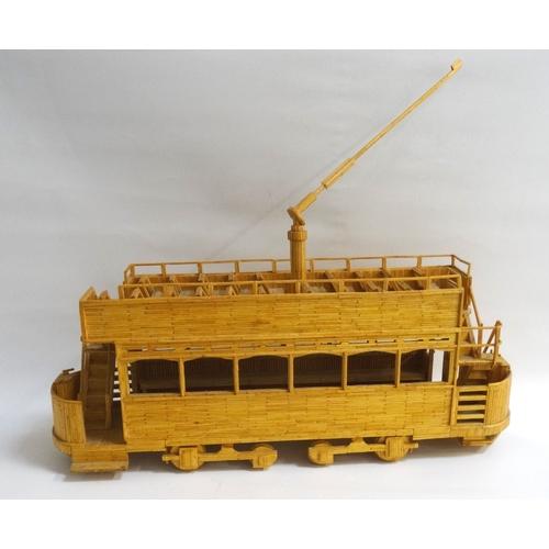 218 - MATCHSTICK MODEL OF A VINTAGE OPEN TOP TRAM 52.5cm long...