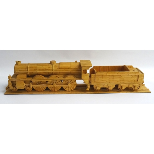 219 - MATCHSTICK MODEL OF A STEAM ENGINE LOCOMOTIVE AND TENDER on a section of matchstick track, 58.5cm lo...