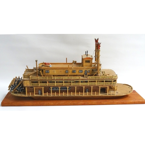 220 - MATCHSTICK MODEL OF A MISSISSIPPI PADDLE STEAMER The King Of Mississippi, on a plinth base, 63cm lon...