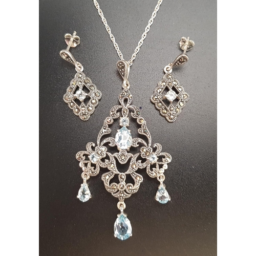 14 - SUITE OF AQUAMARINE AND MARCASITE JEWELLERY comprising a pendant and matching earrings, all in silve...