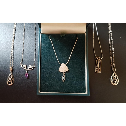 20 - FIVE SILVER PENDANTS ON SILVER CHAINS including a boxed Oal Gorie Drift Collection pendant with blue...