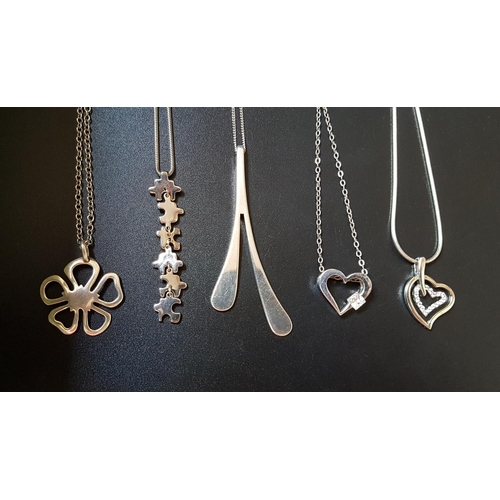 35 - FIVE SILVER PENDANTS ON SILVER CHAINS comprising one with jigsaw style links, two CZ set heart shape...