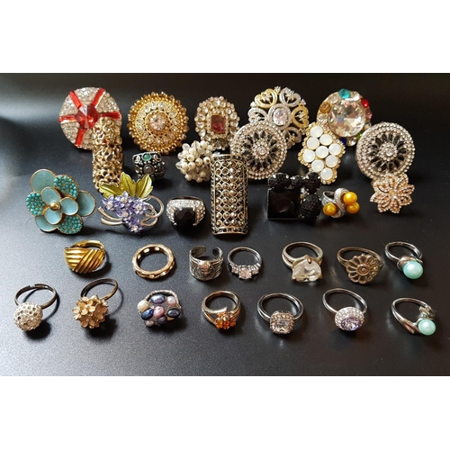36 - SELECTION OF COSTUME JEWELLERY RINGS of various sizes and designs, including stone and paste set exa...