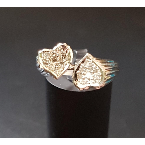 42 - UNUSUAL DIAMOND SET RING in unmarked white gold with pave set diamond heart shaped finials, ring siz...