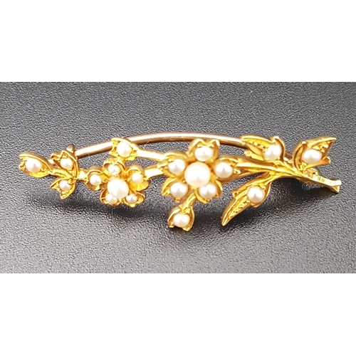44 - SEED PEARL FLORAL SPRAY BROOCH in unmarked high carat gold, approximately 3.9cm long...
