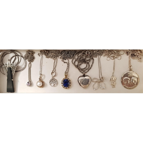 64 - SELECTION OF NINE SILVER PENDANTS ON SILVER CHAINS including an Art Deco marcasite and black stone s...