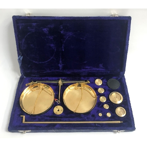 266 - CASED SET OF BRASS MINIATURE APOTHECARY SCALES with weights, in fitted case...