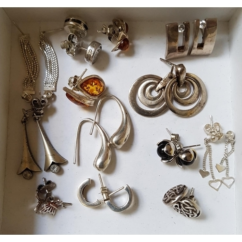 29 - SELECTION OF SILVER EARRINGS including two pairs of amber set stud earrings, a Celtic motif decorate...