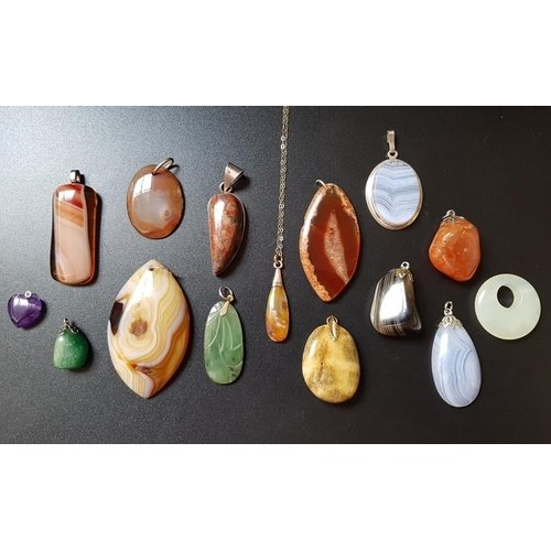 32 - GOOD SELECTION OF AGATE AND HARDSTONE PENDANTS including one on fine nine carat gold chain, another ...