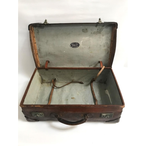 207 - VINTAGE LEATHER SUITCASE with reinforced corners and with monogram A.B.S., the interior with luggage...