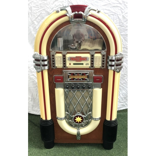 287 - 1940'S STYLE BABY JUKEBOX in a shaped case with compact disc operation and an FM/AM radio, 100cm hig...