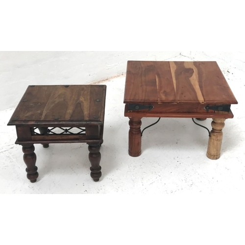 351 - TWO TEAK OCCASIONAL TABLES with decorative ironwaork and raised on turned supports, 60cm x 60cm and ...