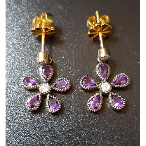 18 - PAIR OF AMETHYST AND DIAMOND CLUSTER EARRINGS the flower head drops on each formed with pear cut ame...