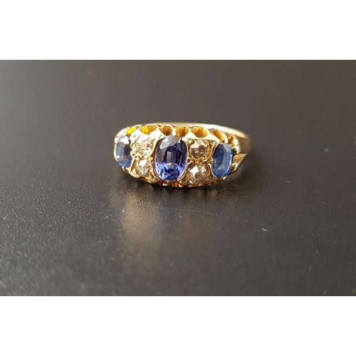 3 - SAPPHIRE AND DIAMOND RING the three graduated oval cut sapphires separated by smaller diamonds, on e...