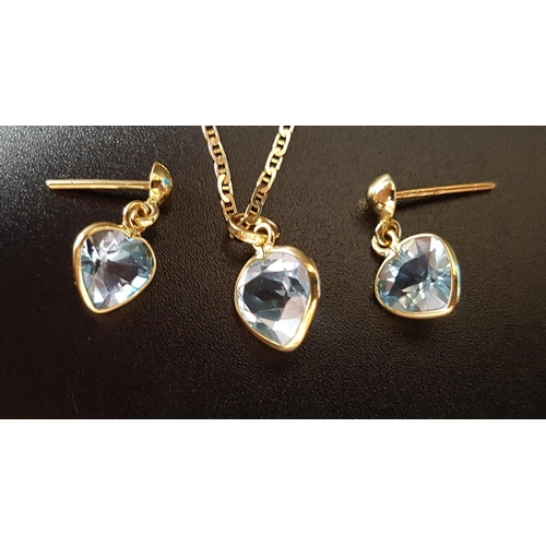 8 - BLUE TOPAZ SUITE OF JEWELLERY comprising a pair of earrings and a pendant, all with heart cut blue t...