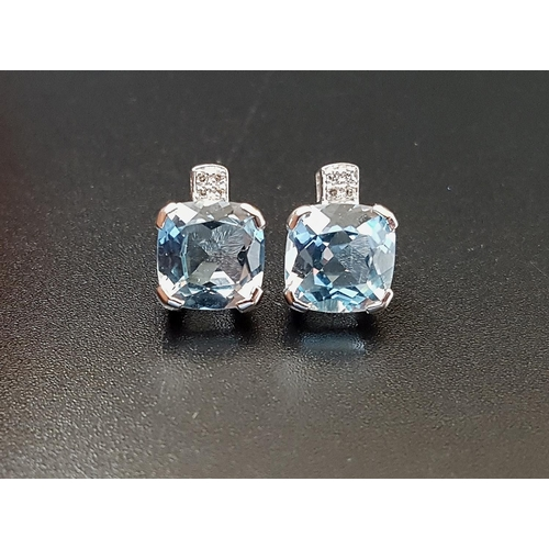 9 - PAIR OF BLUE TOPAZ AND DIAMOND STUD EARRINGS the cushion cut blue topaz on each approximately 2cts b...