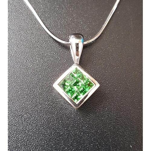 20 - TSAVORITE GARNET PENDANT the nine gemstones totaling approximately 0.53cts in rhomboid shaped eighte...