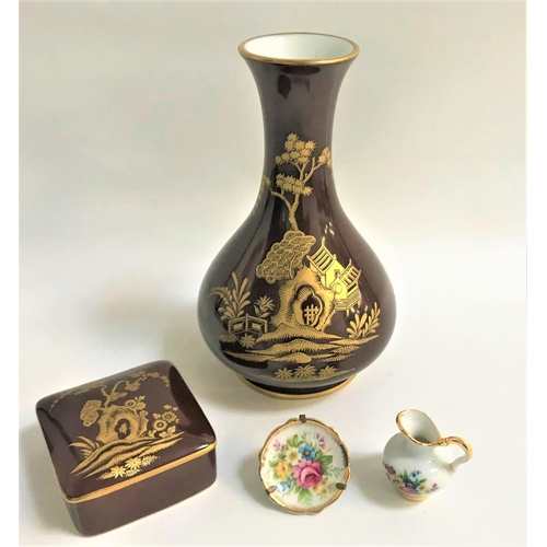28 - LIMOGES SEOUL PATTERN VASE with a brown ground decorated with trees, plants and houses, 22cm high, a...