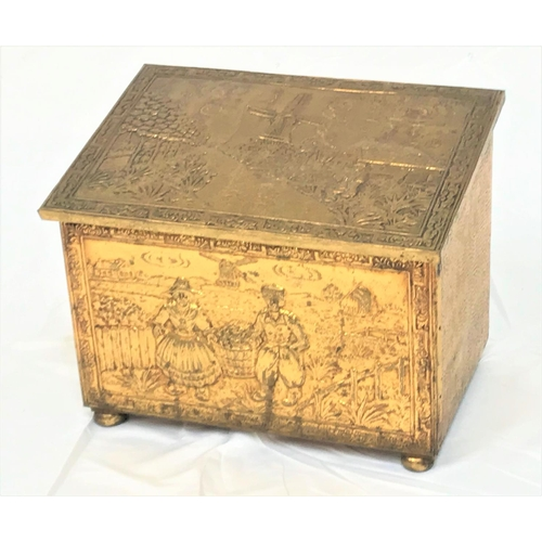 32 - BRASS EMBOSSED COAL BIN  decorated with Dutch scenes, standing on bun feet, 46cm wide...
