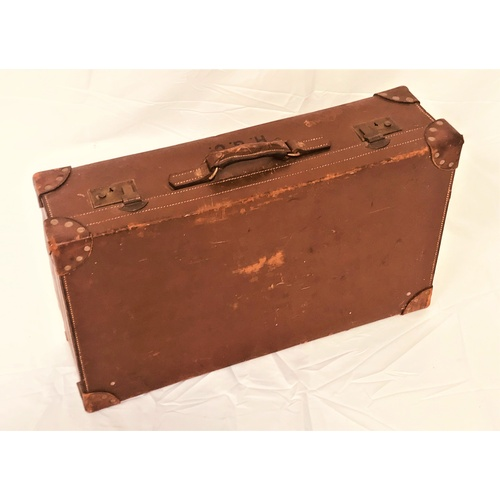 38 - VINTAGE LEATHER SUITCASE with reinforced corners and carry handle, embossed H.G.V. 72.5cm wide...