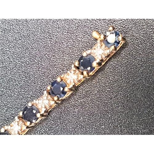2 - SAPPHIRE AND DIAMOND LINE BRACELET the round cut sapphires separated by small illusion set diamonds,...