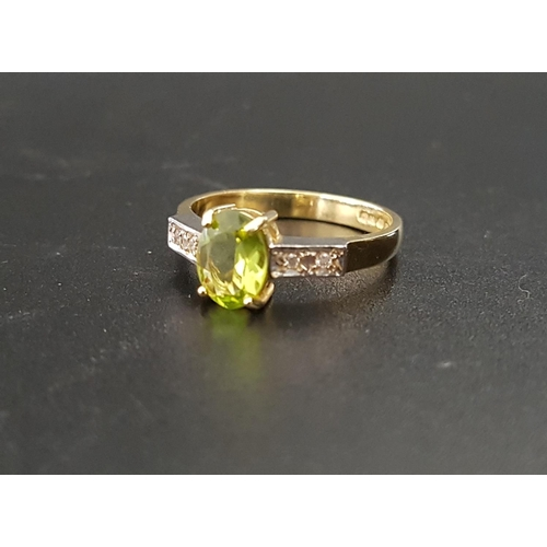 3 - PERIDOT AND DIAMOND RING the central oval cut peridot approximately 1ct flanked by two small diamond...