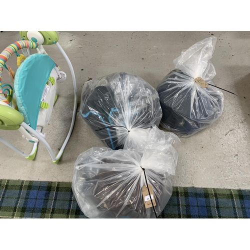 13 - THREE BAGS OF PRAM AND BABY ACCESSORIES including baby carriers, change mats, rain covers, etc.; tog...