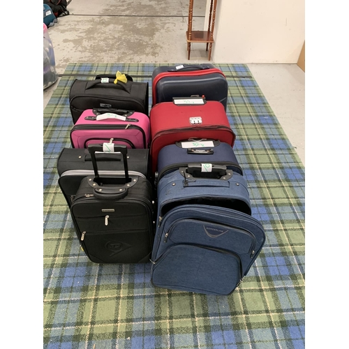 30 - SELECTION OF EIGHT SUITCASES   various sizes. Including No Fear, Dunlop, Borderline and Challener Tr...