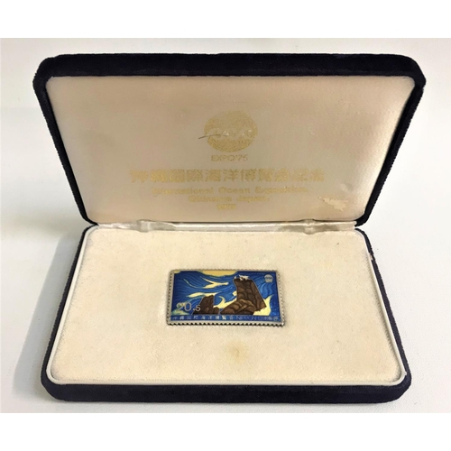 212 - ENAMEL DECORATED SILVER STAMP produced for the International Ocean Exposition, Okinawa, Japan in 197...