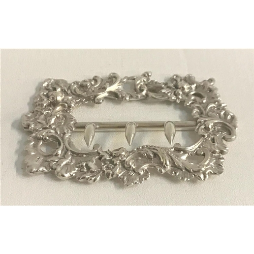 214 - VICTORIAN SILVER BUCKLE with profuse embossed floral and scroll decoration, hallmarked for 1888, mak...