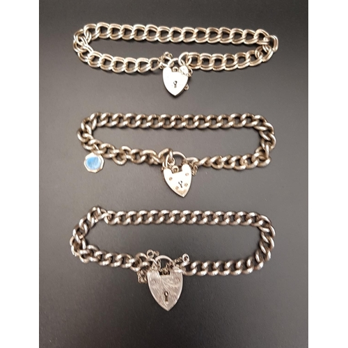 38 - THREE SILVER CURB LINK BRACELETS all with silver heart padlock clasp, total weight 48.3 grams (3)...