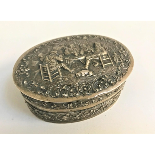 219 - DUTCH SILVER TRINKET BOX the hinged oval box with profuse figure and scroll decoration overall, the ...