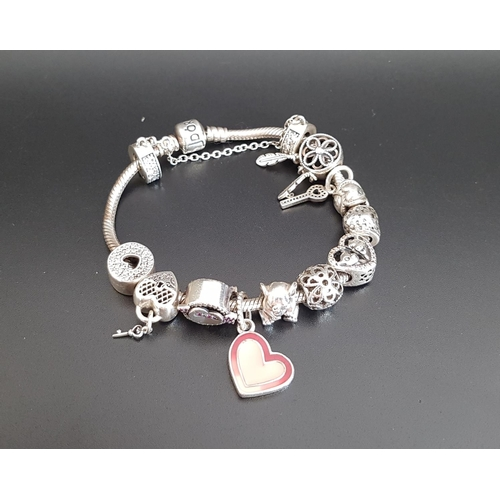 8 - PANDORA MOMENTS SILVER CHARM BRACELET with a good selection of eleven charms including gem set heart...