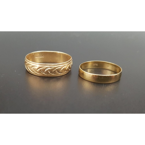 19 - TWO NINE CARAT GOLD WEDDING BANDS the larger example with engraved decoration, ring sizes T and N, t...