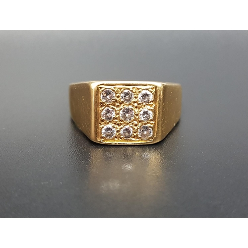 27 - DIAMOND SET EIGHTEEN CARAT GOLD DRESS RING the nine diamonds in square setting totaling approximatel...