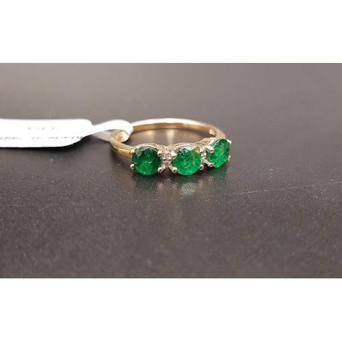 28 - CERTIFIED EMERALD AND DIAMOND RING the three round cut Luhlaza emeralds totaling 1.05cts separated b...