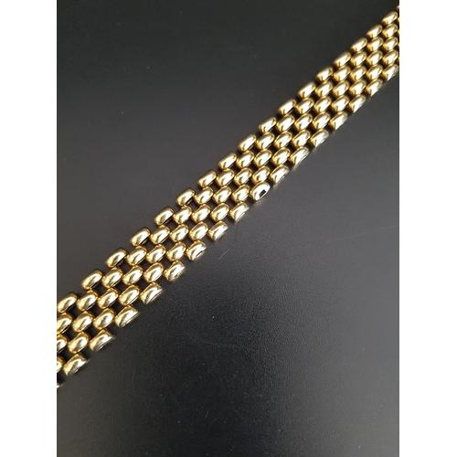30 - NINE CARAT GOLD BRACELET the rectangular links of mesh design, approximately 21.5cm long and 1.2cm w...