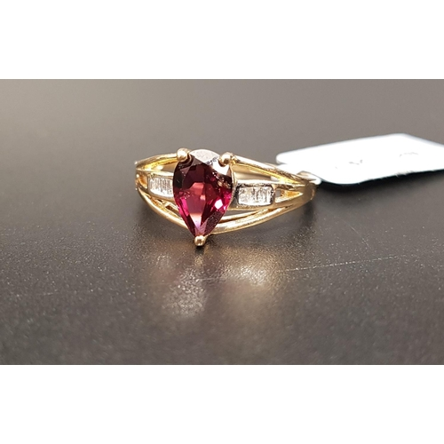 40 - CERTIFIED GARNET AND DIAMOND RING the central pear cut Rajasthan garnet weighing 1.62cts, flanked by...