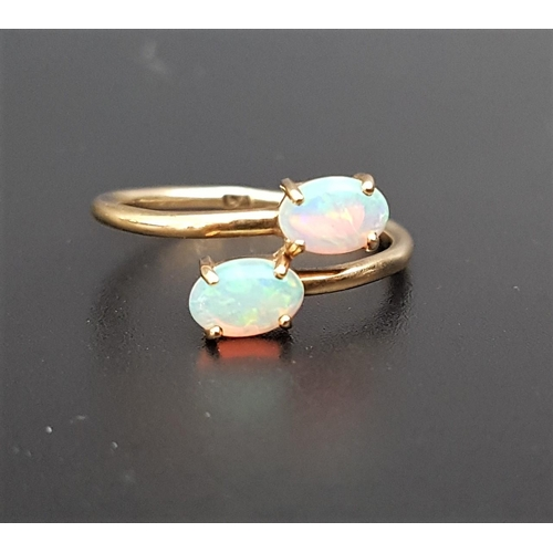 18 - OPAL TWIST DESIGN RING the two oval cabochon opals on nine carat gold shank, ring size N...