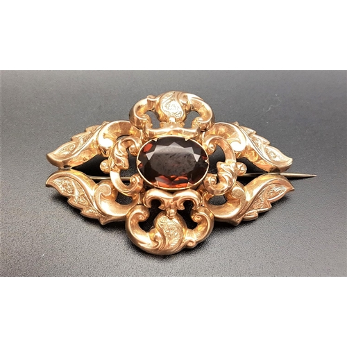 49 - VICTORIAN QUARTZ SET BROOCH the pierced scroll decorated unmarked gold brooch with central oval cut ...