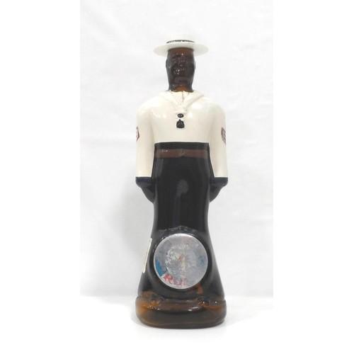 683 - DOORLY'S BARBADOS RUM BOTTLE An empty but interesting painted Doorly's Barbados Rum bottle in the sh...
